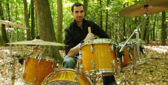 David Oromaner drumming in the woods